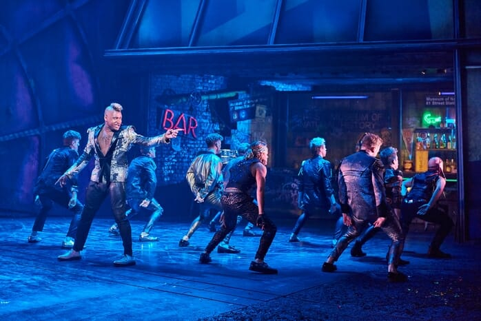 Dom Hartley-Harris as Jagwire (front left) with the cast of BAT OUT OF HELL credit Specular