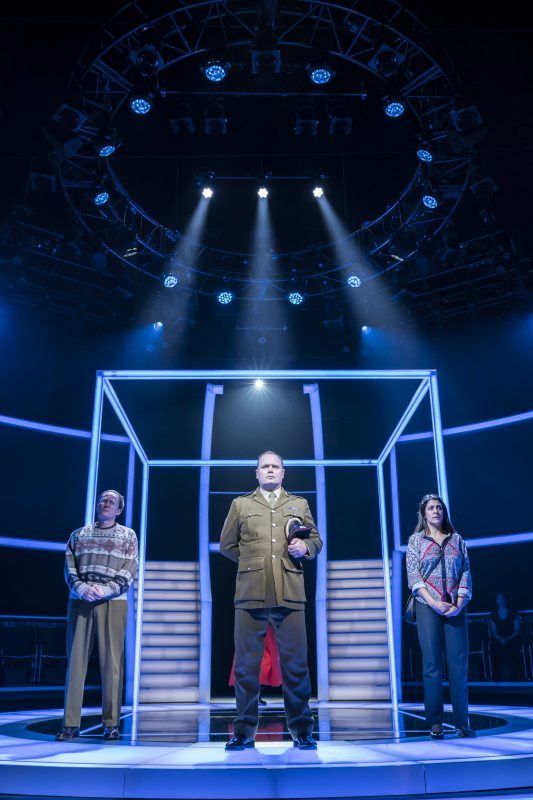 Mark Meadows (Tecwen Whittock), Gavin Spokes (Charles Ingram), Stephanie Street (Diana Ingram). by Johan Persson