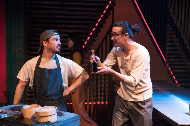 RX Theatre - Andy Kettu (Street Hawker) & Matthew Leonhart (Leung) in Mountains - photo by Jonathan Keenan