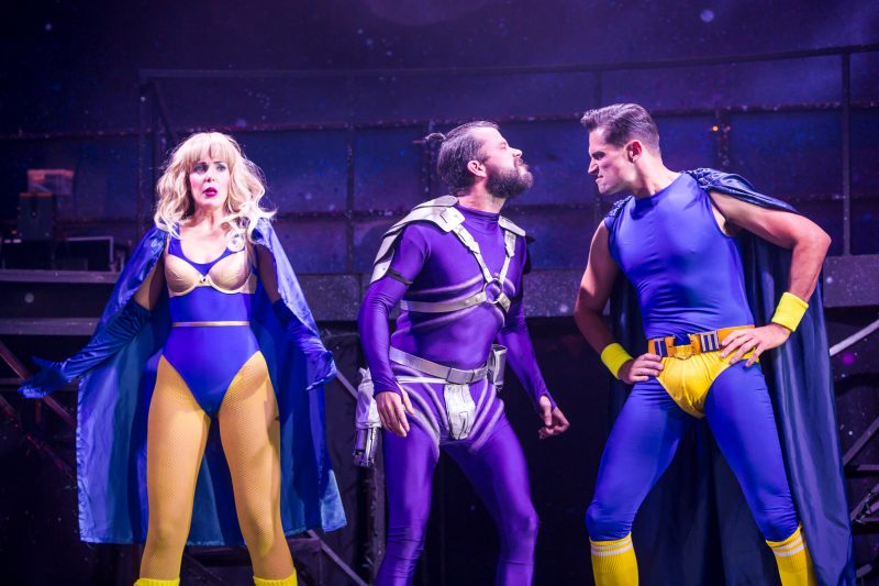 Eugenius Emily Tierney as Carrie, Neil McDermott as Evil Lord Hector and Simon Thomas as Gerhard Photo Scott Rylander