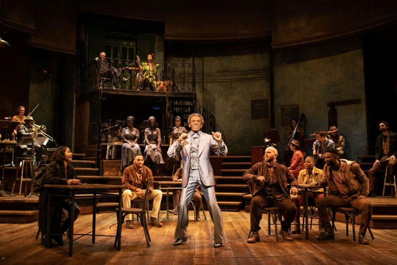 . André De Shields Hermes and the company of Hadestown at National Theatre c Helen Maybanks