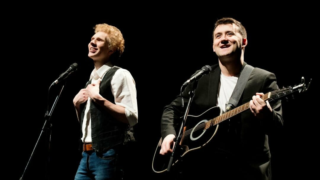 Charles Blyth as Art Garfunkel and Sam OHanlon as Paul Simon