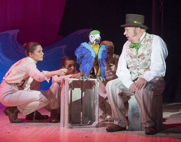 Mark Williams as Doctor Dolittle with Jane Crawshaw and Ellie Seaton as the puppeteers of Polynesia the Parrot in DOCTOR DOLITTLE. Credit Alastiar Muir