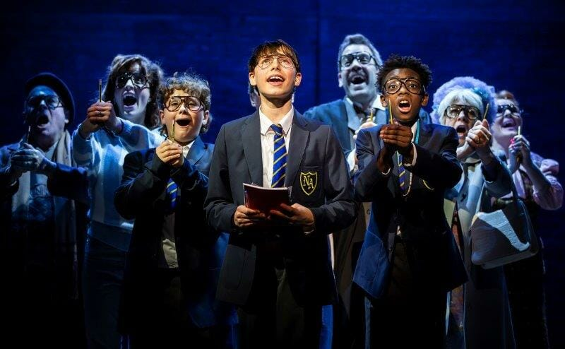 LtoR Jack Gale as Barry Rufus Kampa as Adrian Jeremiah Davan Waysome as Nigel and Cast in Adrian Mole the Musical credit Pamela Raith