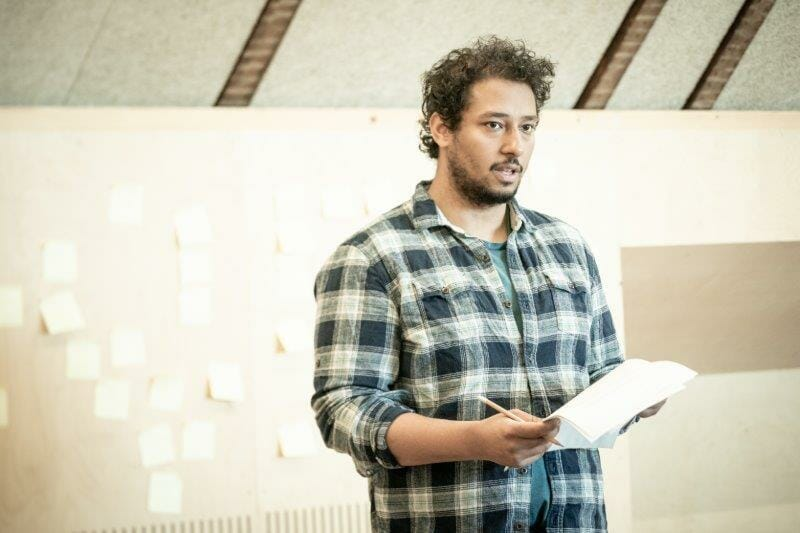 Irfan Shamji in rehearsals for The Arrival. Photo by Marc Brenner REH