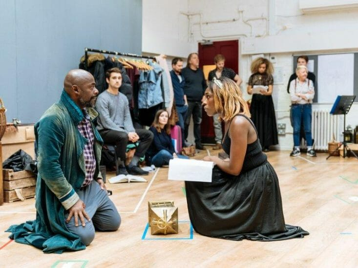 Paterson Joseph Scrooge and Gloria Onitiri Ghost of Christmas Present in rehearsals for A Christmas Carol at The Old Vic. Photo Credit Manuel Harlan