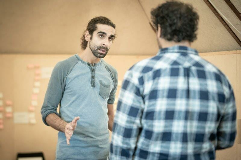 Scott Karim in rehearsals for The Arrival. Photo by Marc Brenner REH