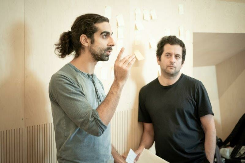 l r Scott Karim and Bijan Sheibani Director in rehearsals for The Arrival. Photo by Marc Brenner REH